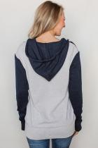 Flerfarvet quiltet hættetrøje med halv lynlås