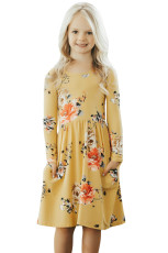 Floral Mustard Swing Dress med skjulte lommer