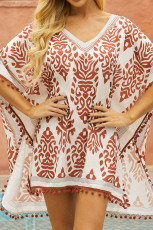 Oransje blomstertrykk Tassel Hem Beach Cover up