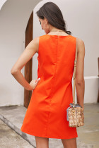 Abito senza maniche con bottoni arancio