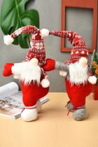 Žádná tvář Pletená opona Santa Claus drží vánoční ozdoba