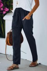 Calça elástica azul casual com cordão na cintura e bolsos