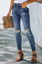 Jeans skinny effetto consumato a vita alta