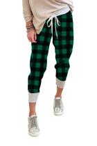 Зеленые брюки-джоггеры в клетку на кулиске
