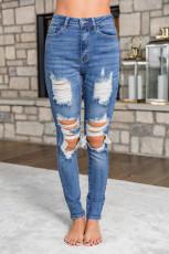 Рваные джинсы скинни средней стирки