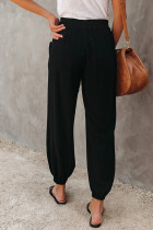 Sort jomfrujakke med lomme i lomme og lomme