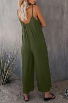 Зеленые комбинезоны с карманами на тонких бретелях и широкими штанинами