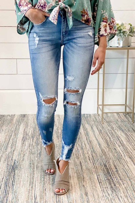 Faded Mid High Rise Jeans with Holes